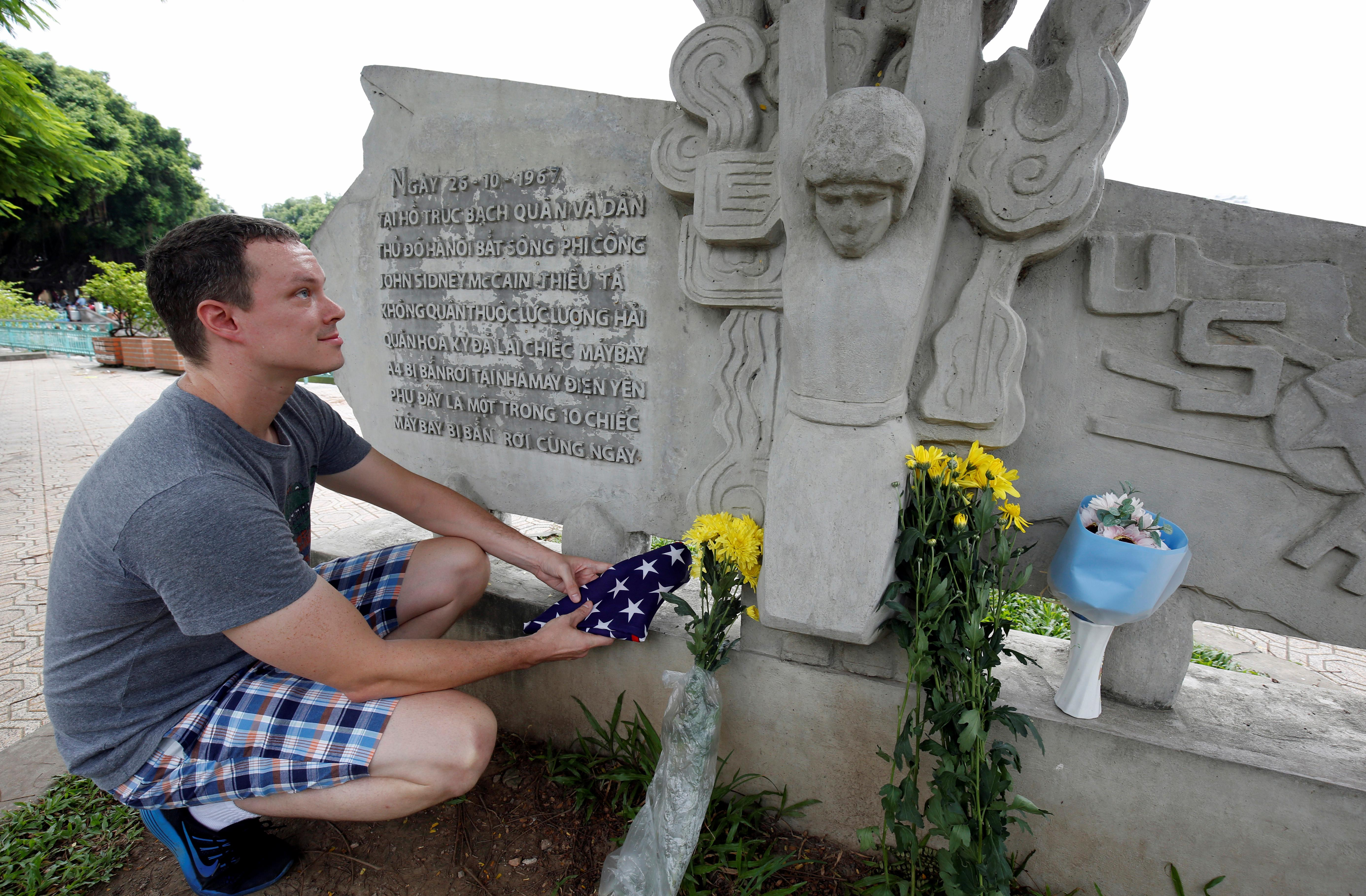 Flowers, tributes offered for McCain at Vietnam War crash site