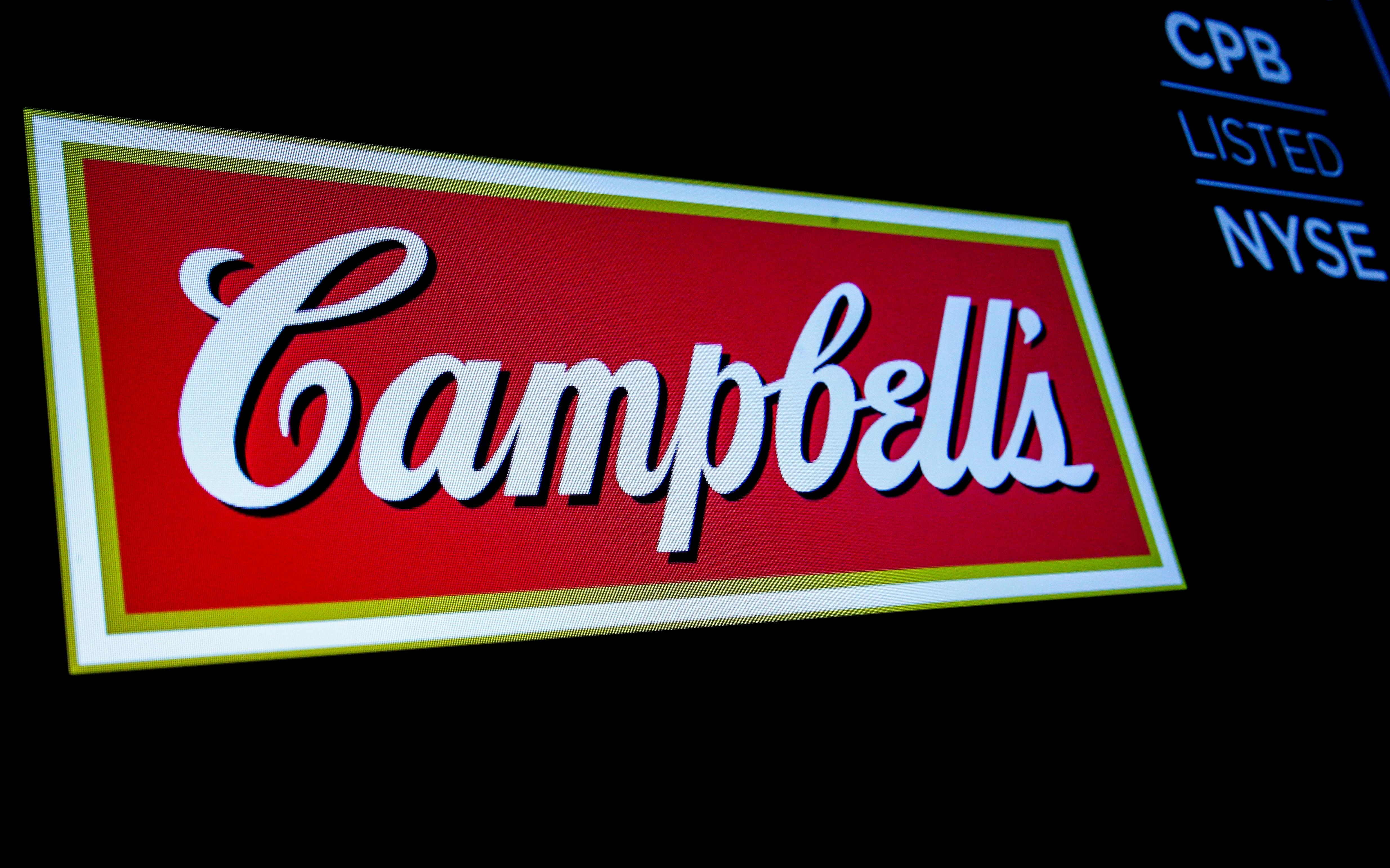 The logo and ticker for Campbell Soup Co. are displayed on a screen on the floor of the New York Stock Exchange (NYSE) in New York, U.S., May 18, 2018. Brendan McDermid