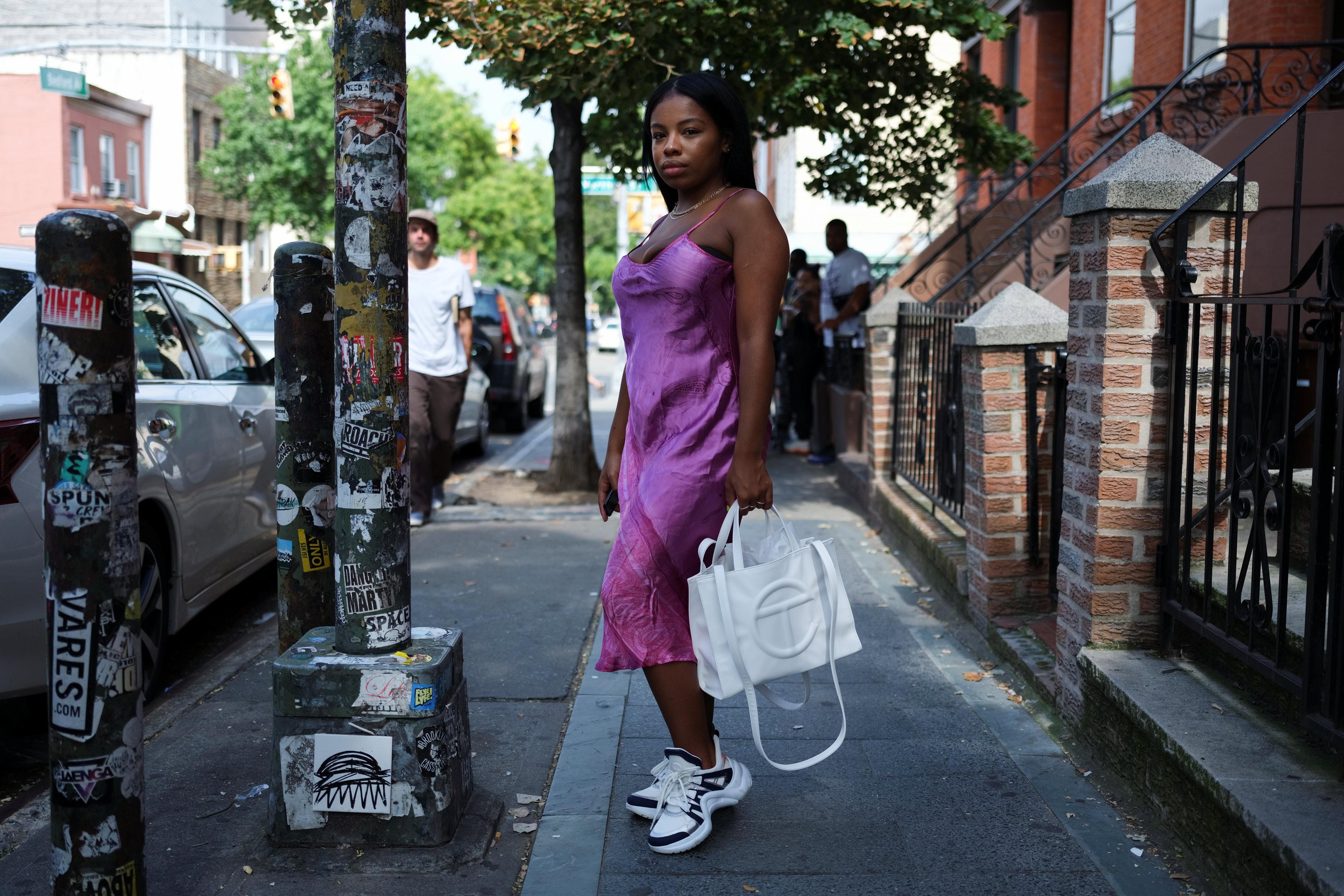 Nia Indigo, 23, a stylist based in New York, poses for a picture wearing a pair of Louis Vuitton Archlight sneakers in the Brooklyn borough of New York, U.S., September 2, 2018.  Caitlin Ochs