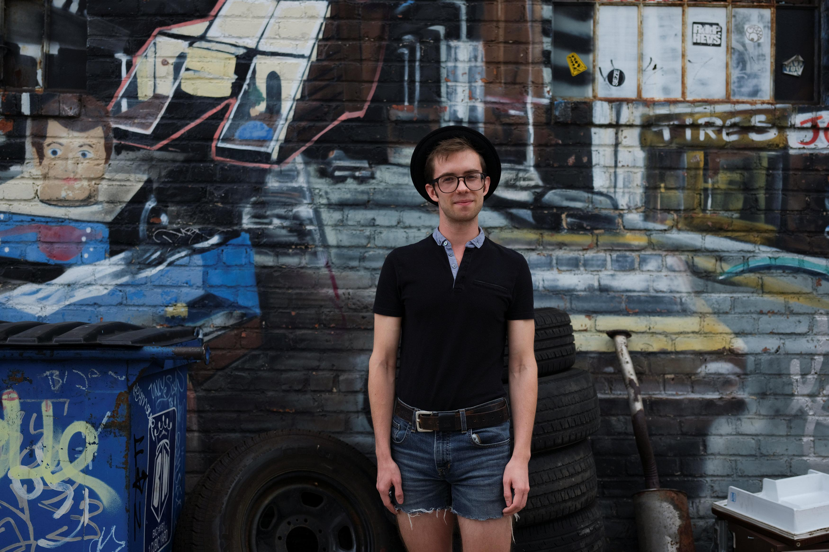 Seth Hatch, 24, an actor who works at a thrift shop in Williamsburg, poses for a picture in the Brooklyn borough of New York, U.S., September 2, 2018.  Caitlin Ochs