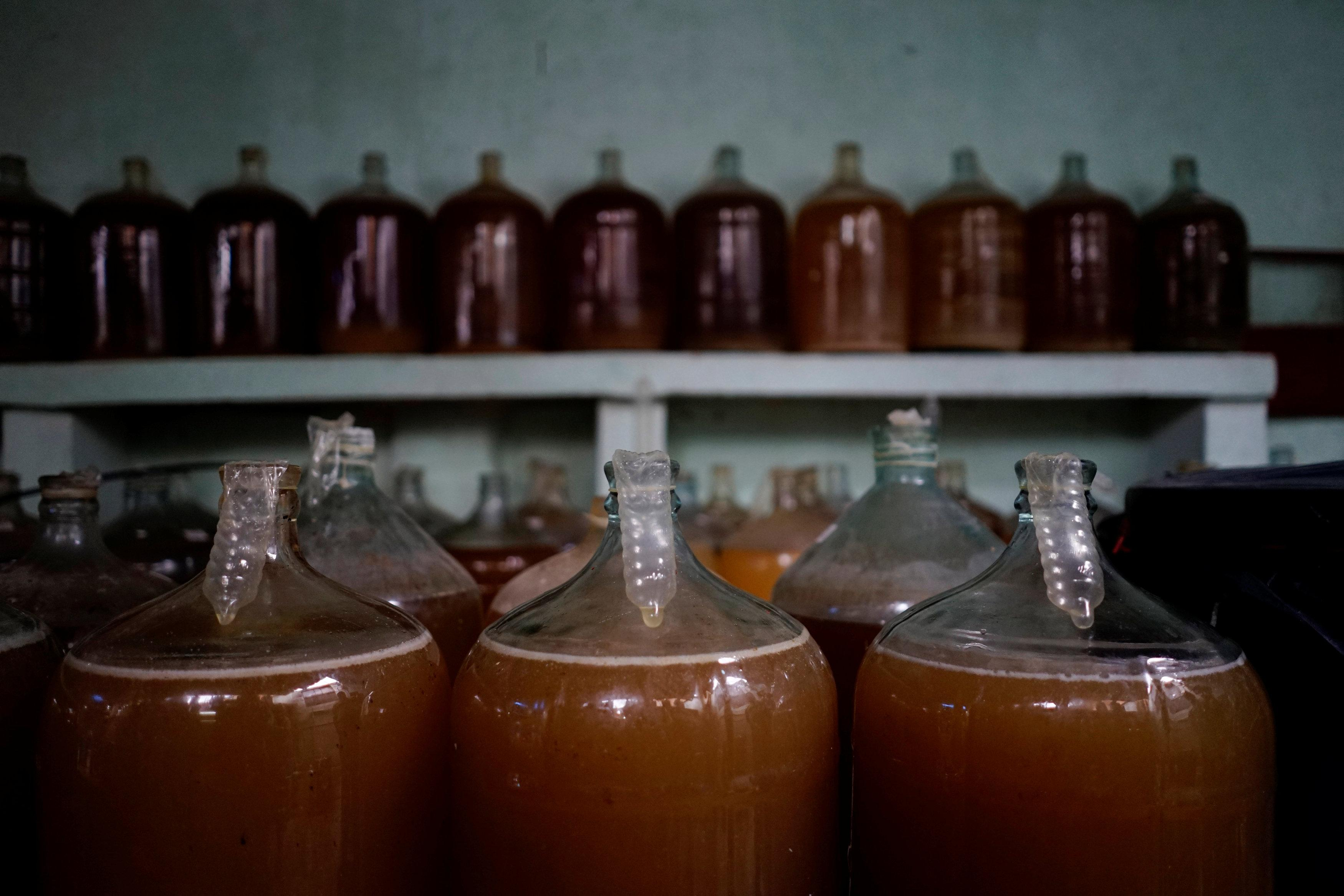Condoms used in the process of wine production are seen in a makeshift winery in Havana, Cuba, May 16, 2018. Picture taken on May 16, 2018. Alexandre Meneghini