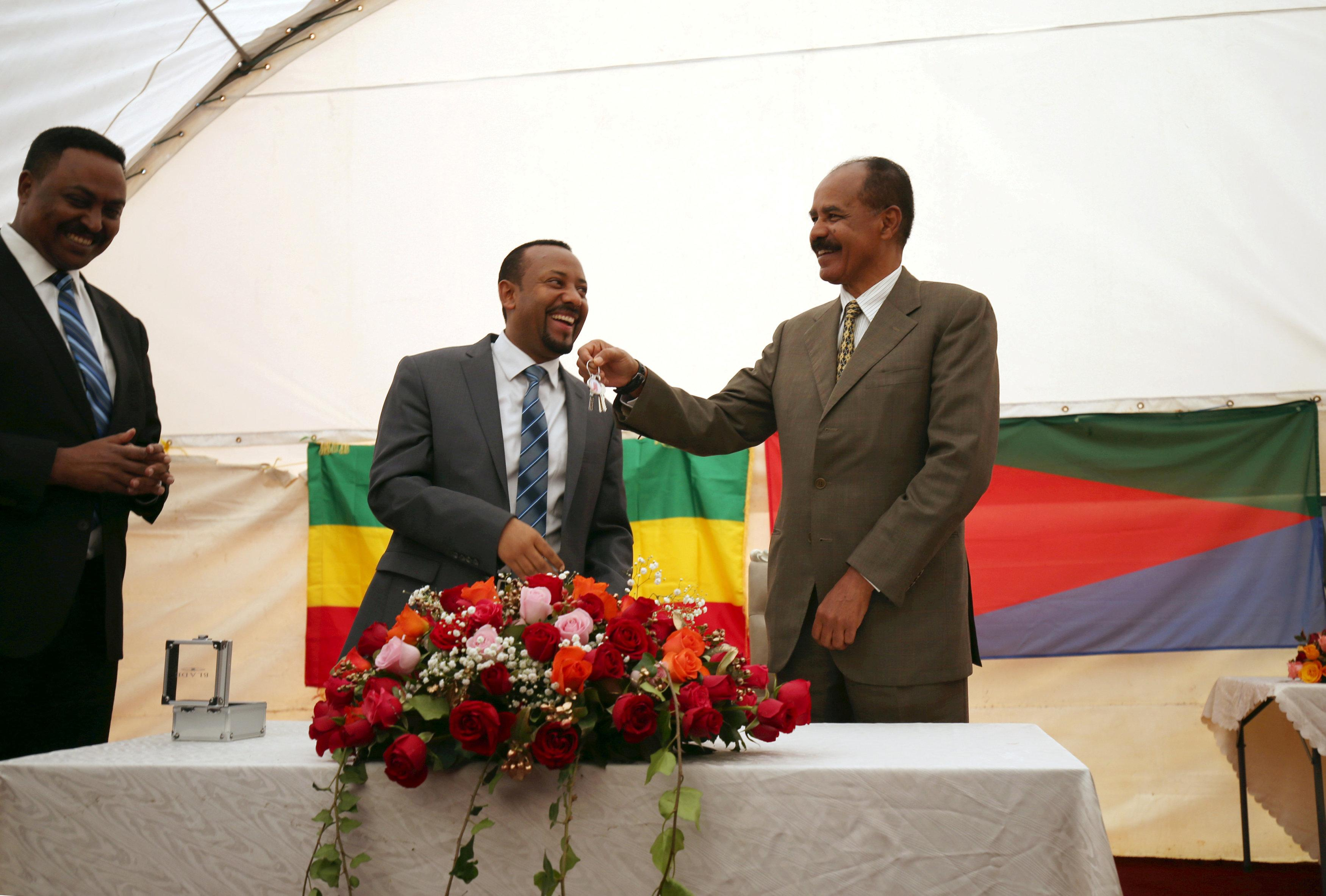 Eritrea's President, Isaias Afwerki receives a key from Ethiopia's Prime Minister, Abiy Ahmed during the Inauguration ceremony marking the reopening of the Eritrean Embassy in Addis Ababa, Ethiopia July 16, 2018. Tiksa Negeri