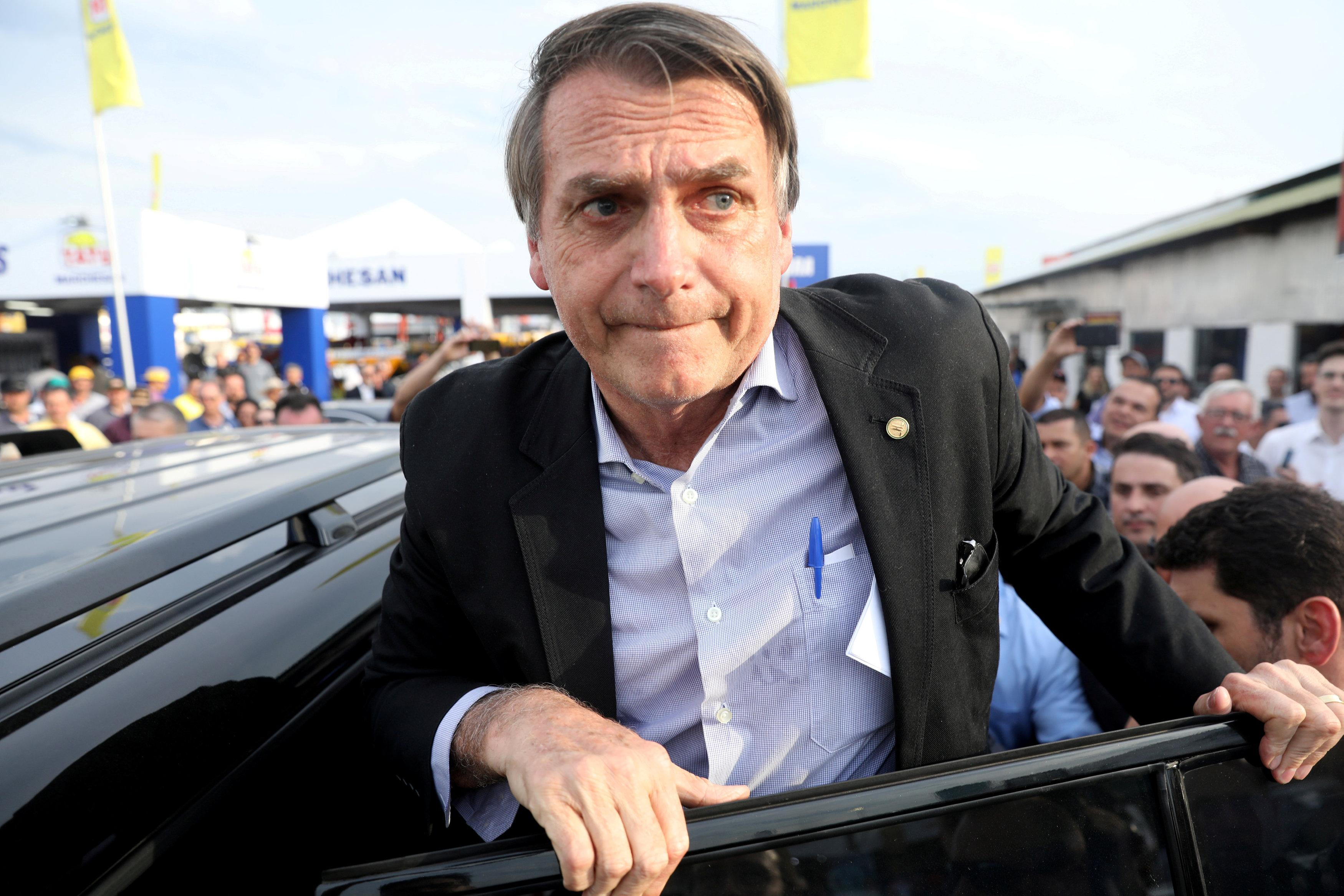 Presidential candidate Jair Bolsonaro leaves an agribusiness fair in Esteio, Rio Grande do Sul state, Brazil August 29, 2018. Diego Vara/File photo