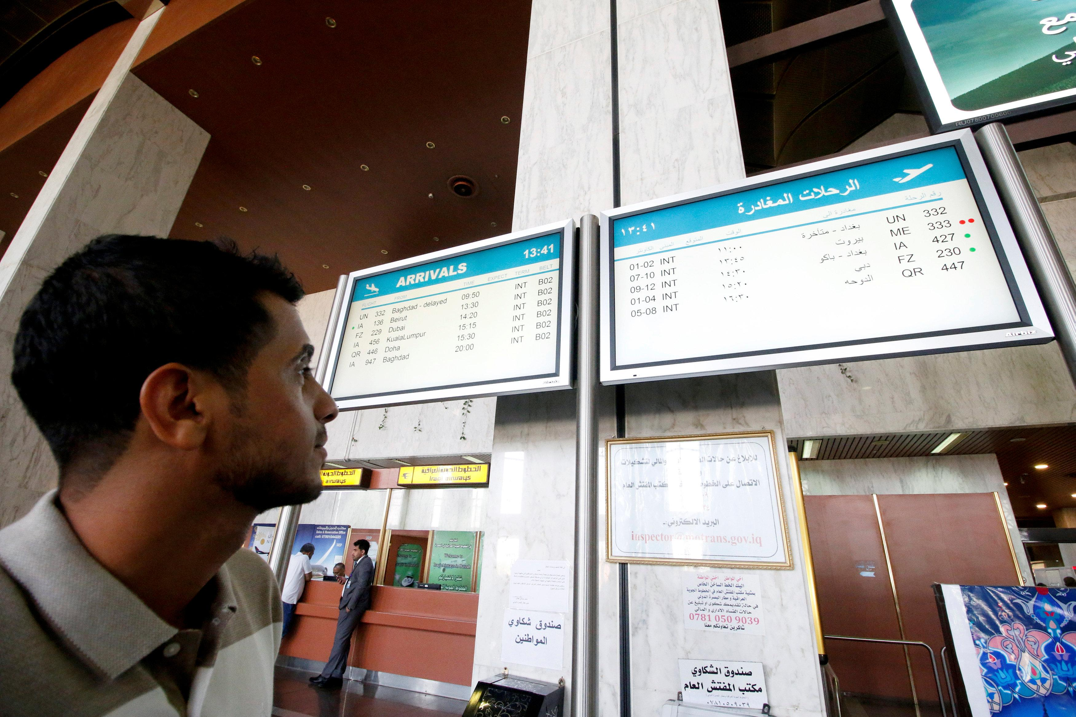 A man looks at a flight information board at Basra airport after it was targeted by rocket fire in Basra, Iraq September 8, 2018. Essam al-Sudani