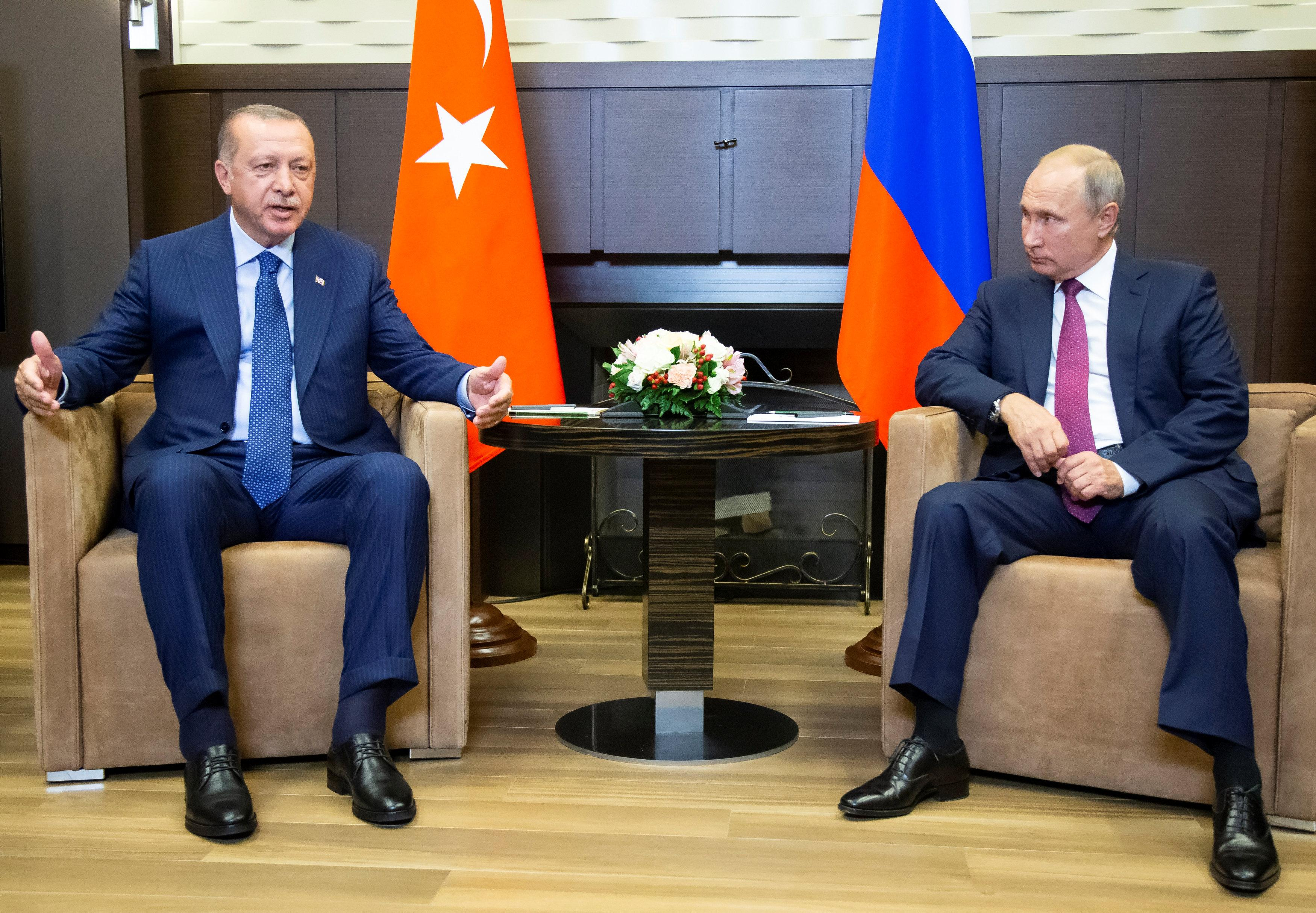 Russian President Vladimir Putin (R) meets with his Turkish counterpart Tayyip Erdogan in Sochi, Russia September 17, 2018. Alexander Zemlianichenko/Pool via
