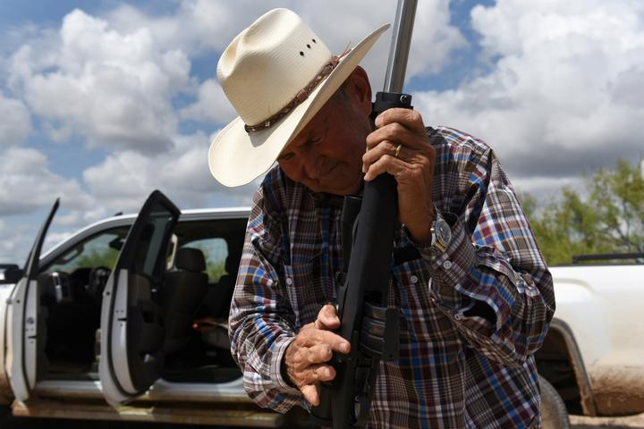 Bill Martin prepares to shoot a rifle from his gun collection on his ranch...