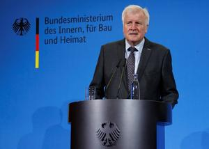 German Interior Minister Horst Seehofer addresses the media at the...