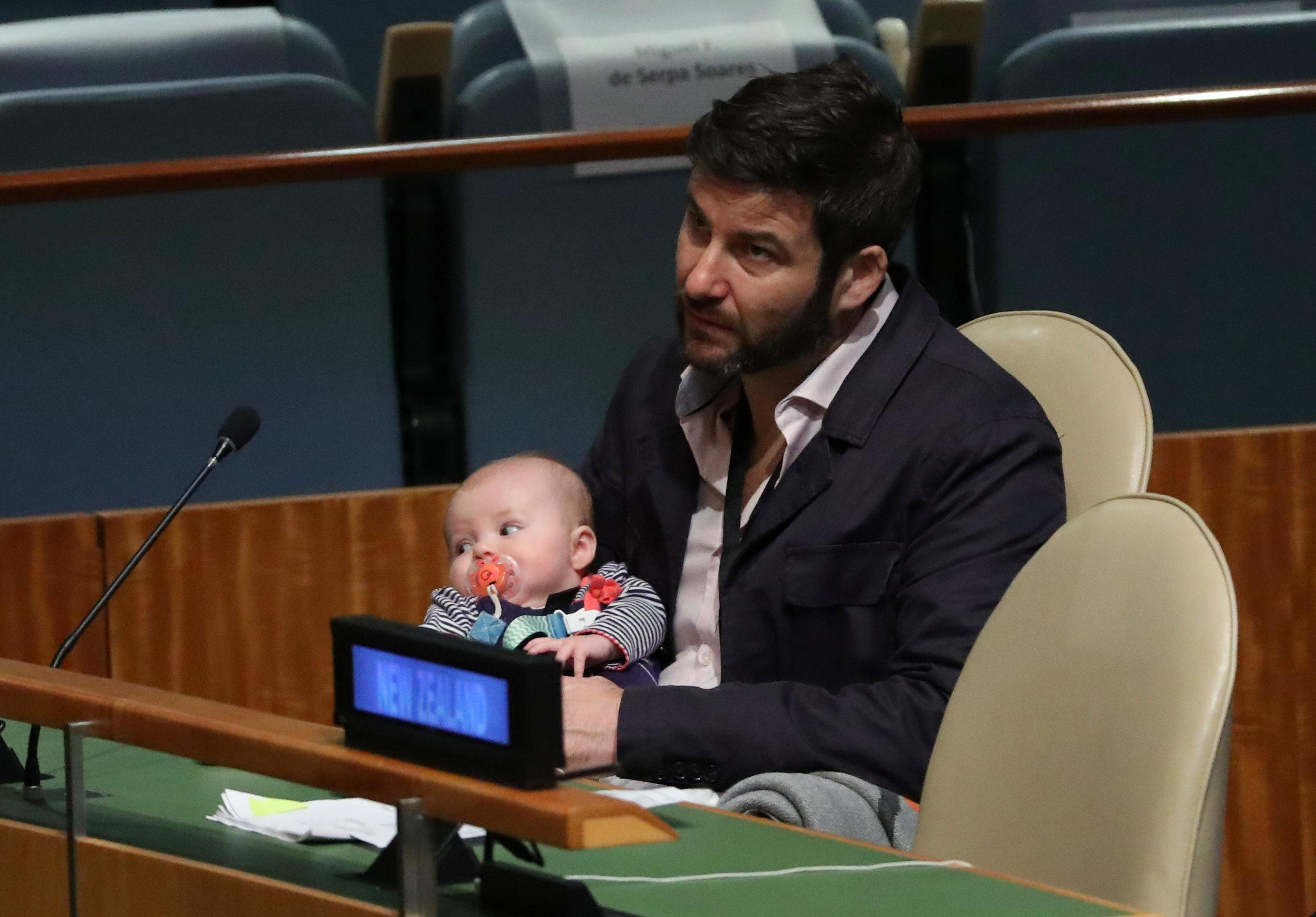 Clarke Gayford, partner to New Zealand Prime Minister Jacinda Ardern holds their baby Neve as Ardern speaks at the Nelson Mandela Peace Summit during the 73rd United Nations General Assembly in New York, U.S., September 24, 2018. Carlo Allegri