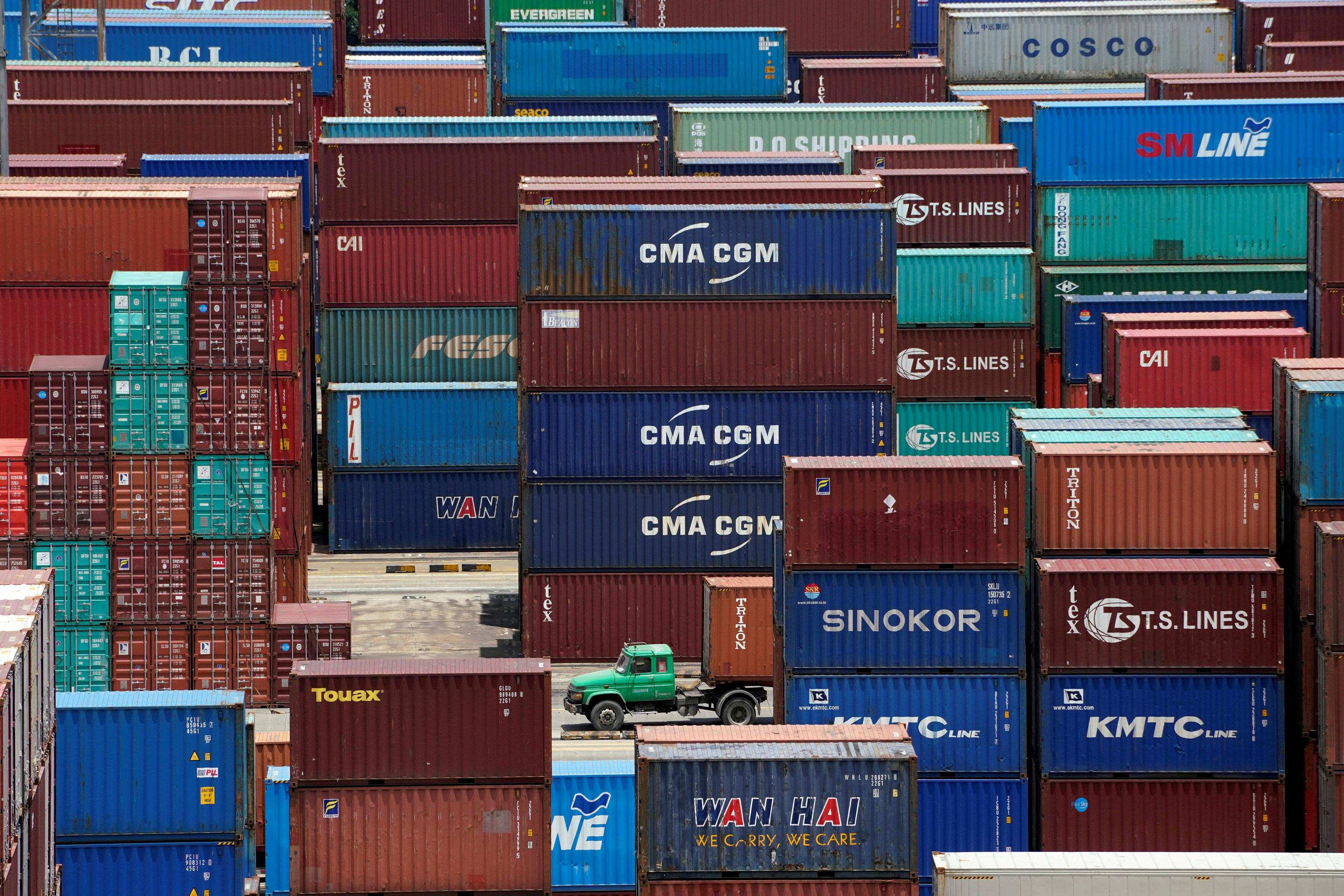 Shipping containers are seen at a port in Shanghai, China July 10, 2018. Aly Song