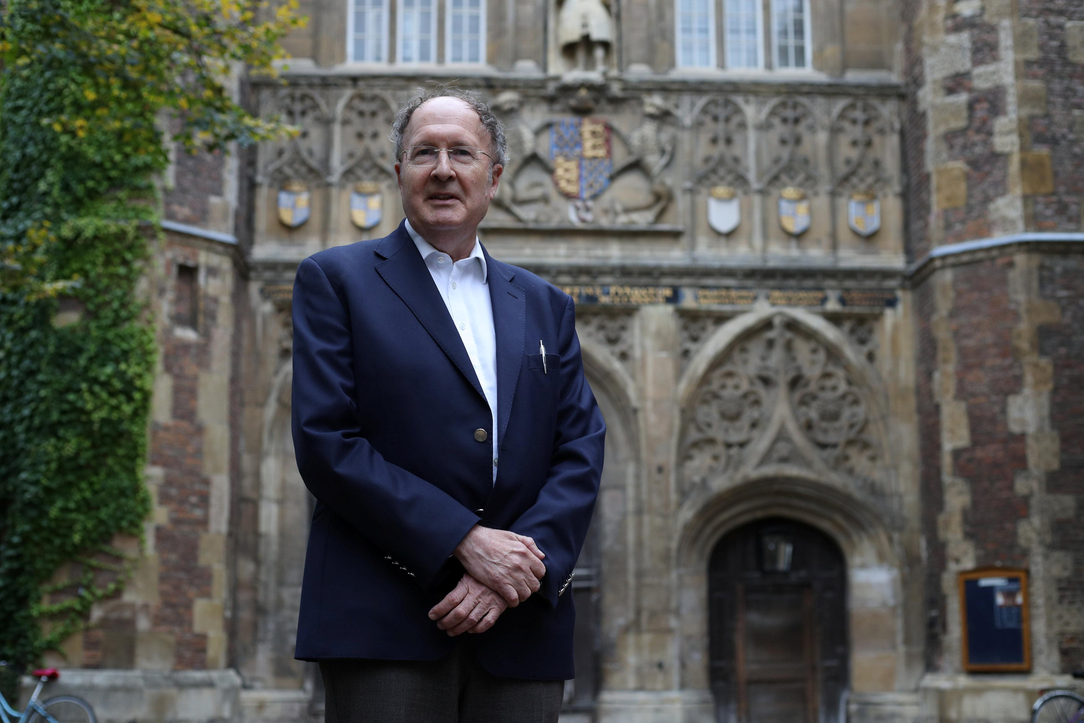 Gregory Winter, poses for photographs after being awarded the Noble Prize for Chemistry, outside Trinity College Cambridge, Britain, October 3, 2018. Chris Radburn
