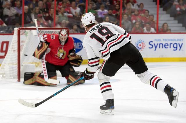 the latest bf966 a1ea8 NHL roundup  Toews  hat trick lifts Blackhawks in OT