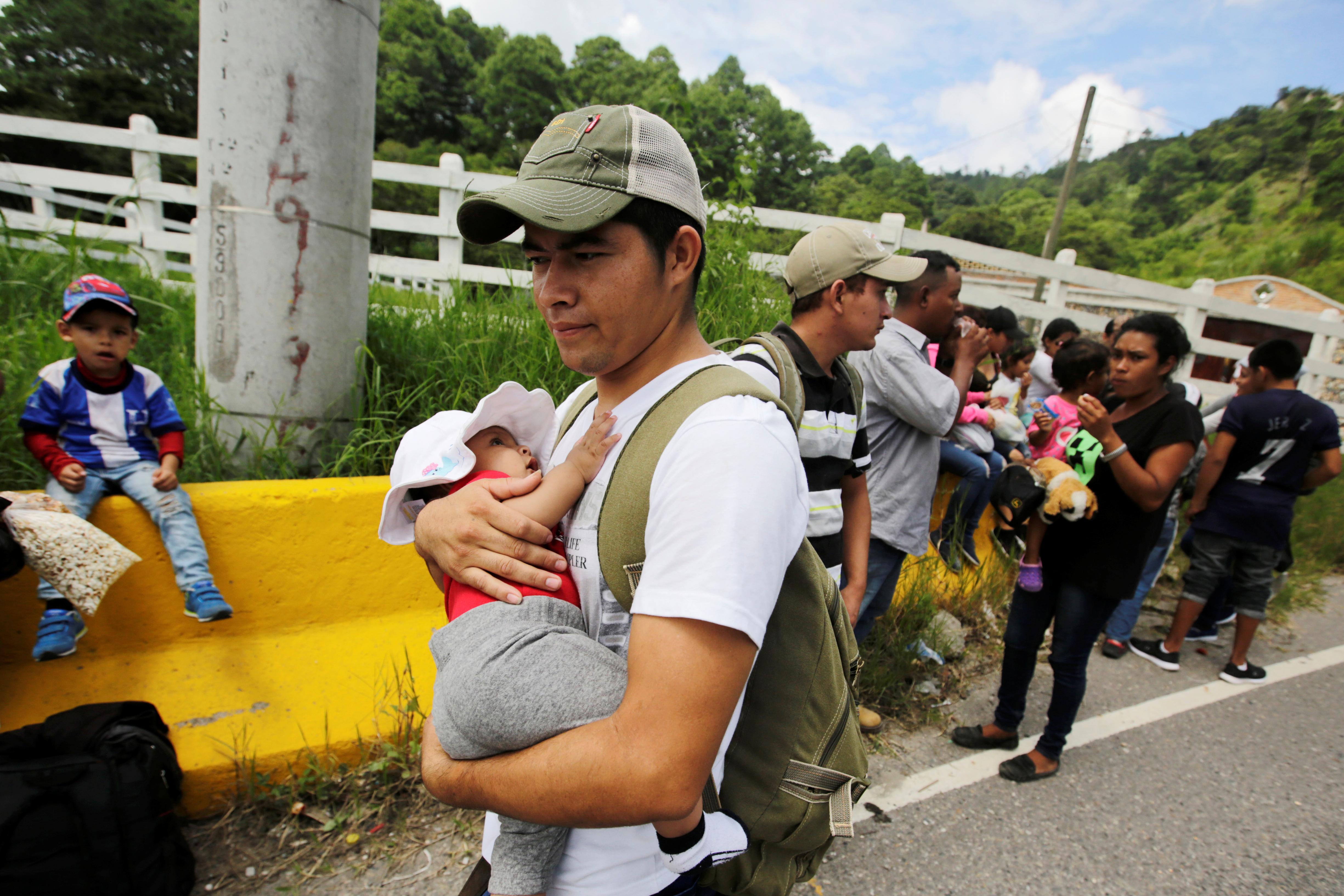 Honduran migrants taking part in a caravan towards the