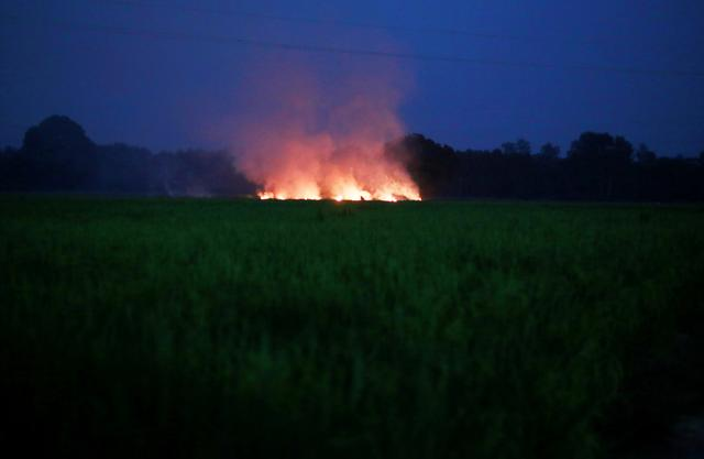 The burning truth: as farmers set fire to fields, Delhi