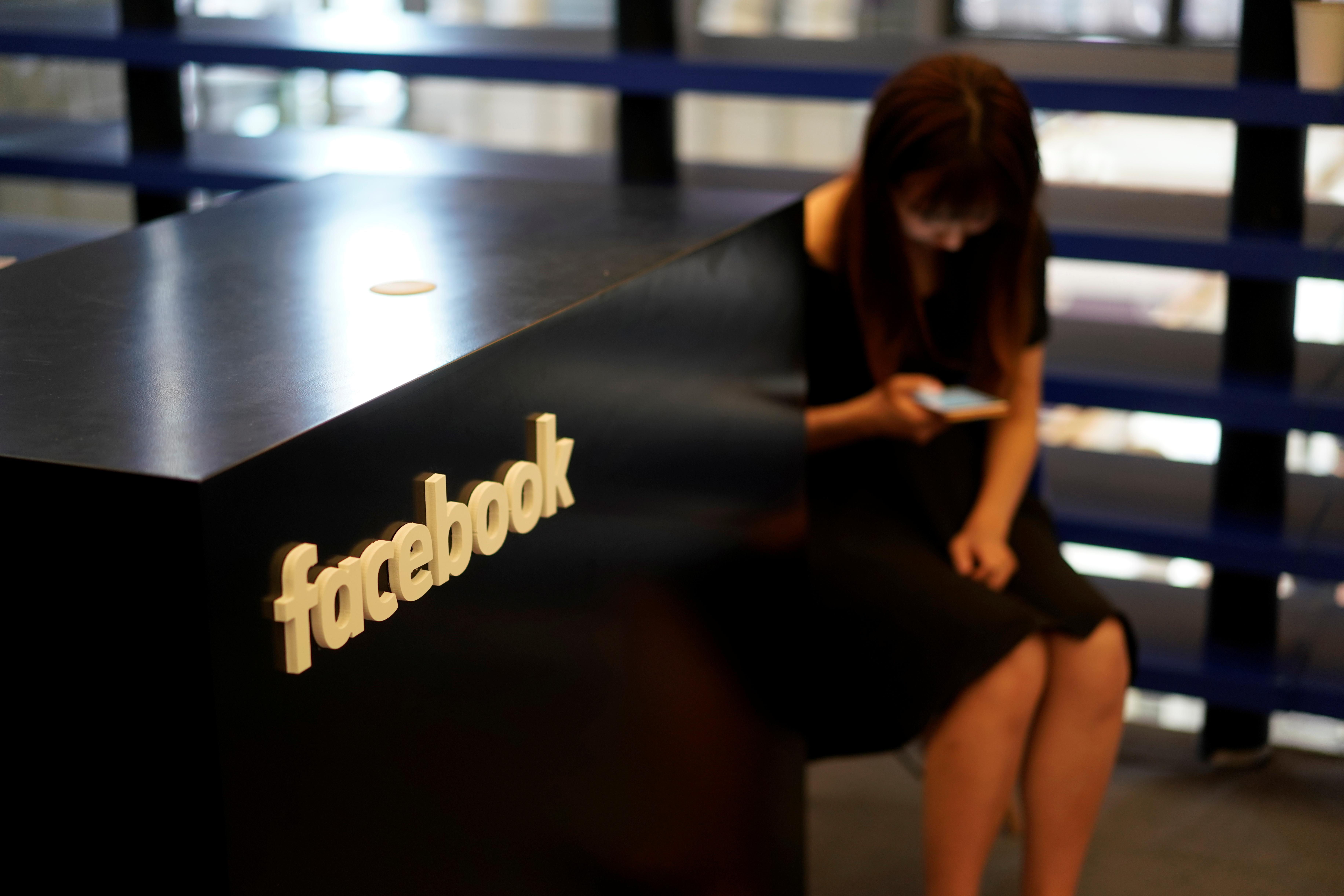 A Facebook sign is seen during the China Digital Entertainment Expo and Conference (ChinaJoy) in Shanghai, China August 3, 2018. Aly Song