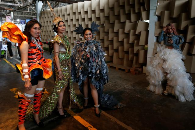 Image result for A model wears a dress made out of recycled material during a show organised by LGBT fashion designers to battles discrimination in Phnom Penh, Cambodia, October 24, 2018.