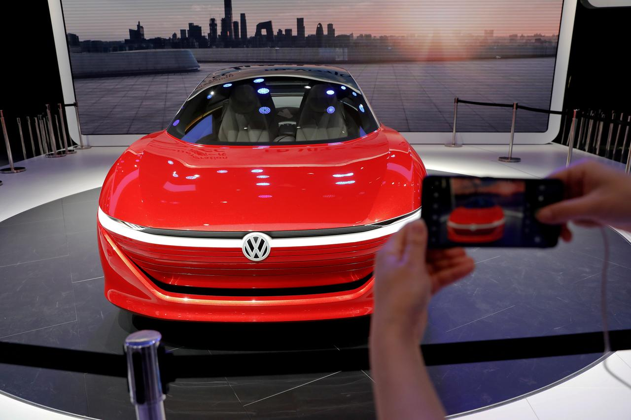 File Photo A Visitor Takes Pictures Of Volkswagen S I D Vizzion Model Car Displayed During Media Preview The Auto China 2018 Motor Show In Beijing