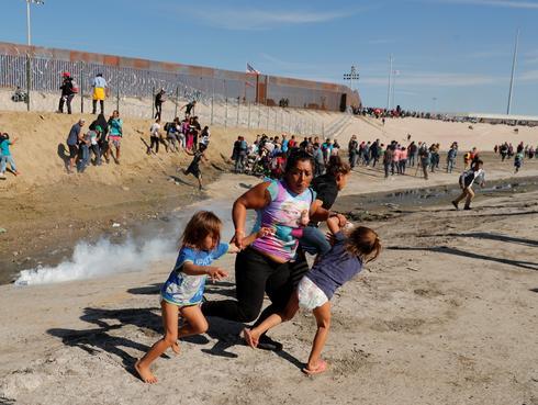 U.S. fires tear gas into Mexico to repel migrants