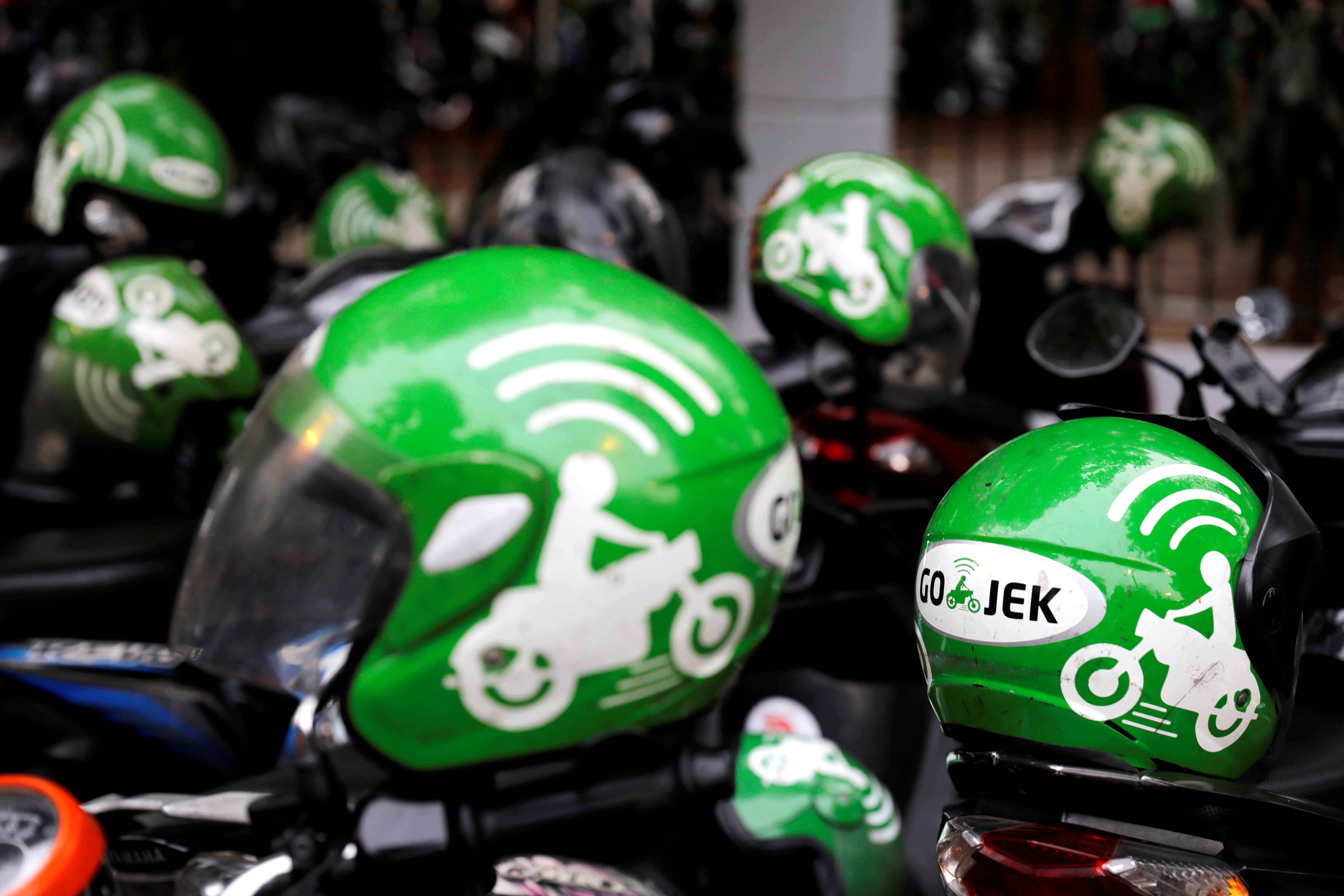 Focus: Grab, Go-Jek wage street fight for SE Asia 'super-app' supremacy