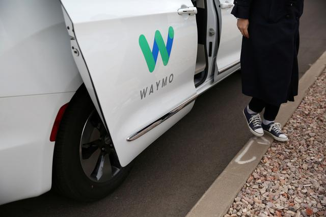 Waymo unveils self-driving taxi service in Arizona for