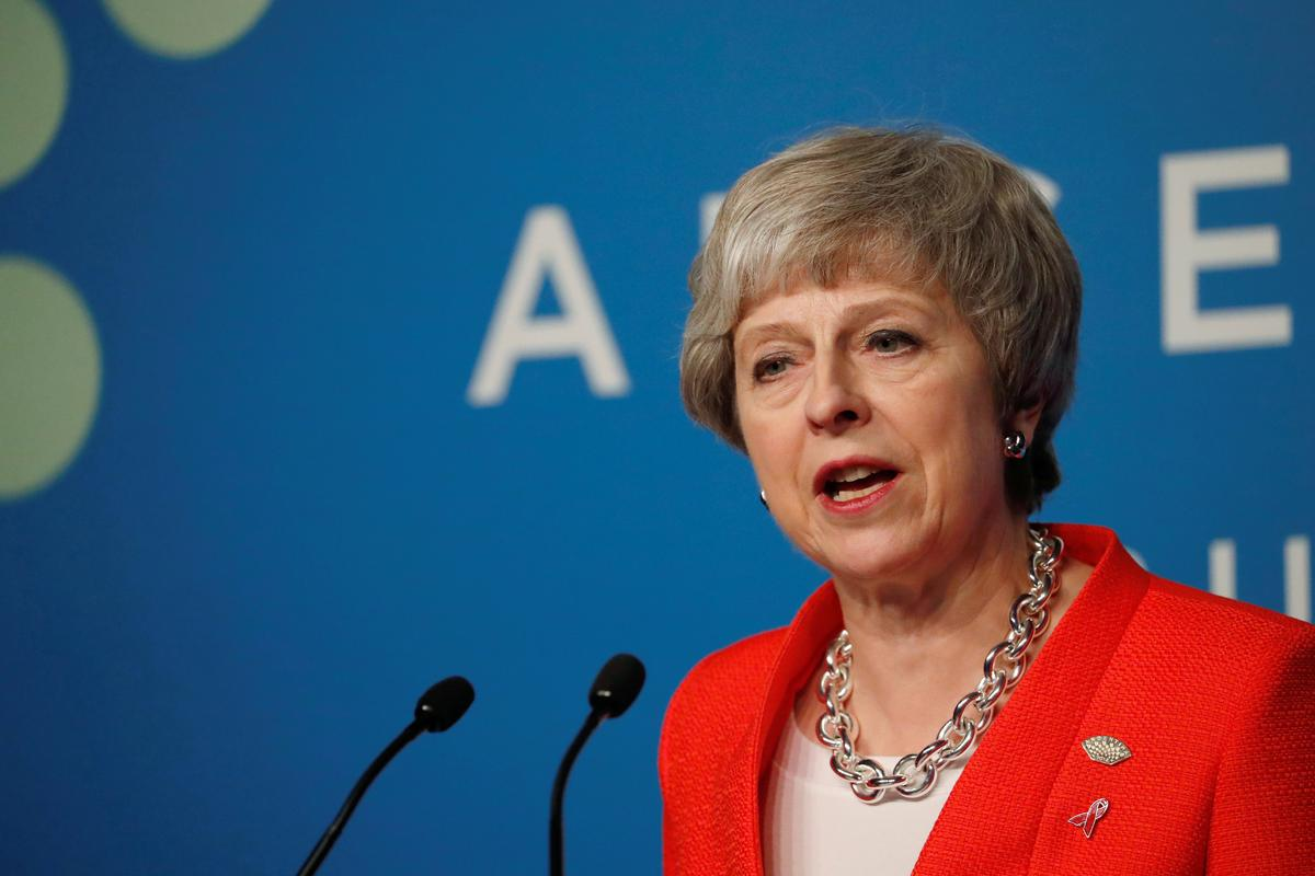 Rejecting suggestions of delay, UK PM May's team says Brexit vote will go ahead