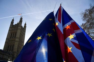 Demonstrators hold EU and Union flags during an anti-Brexit protest...