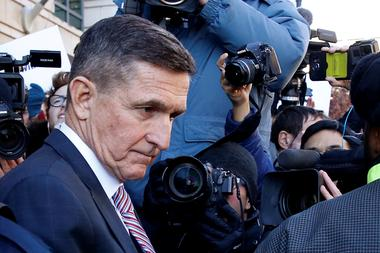Former U.S. national security adviser Flynn departs after sentencing...