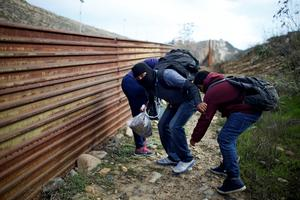 Migrants at the border fence