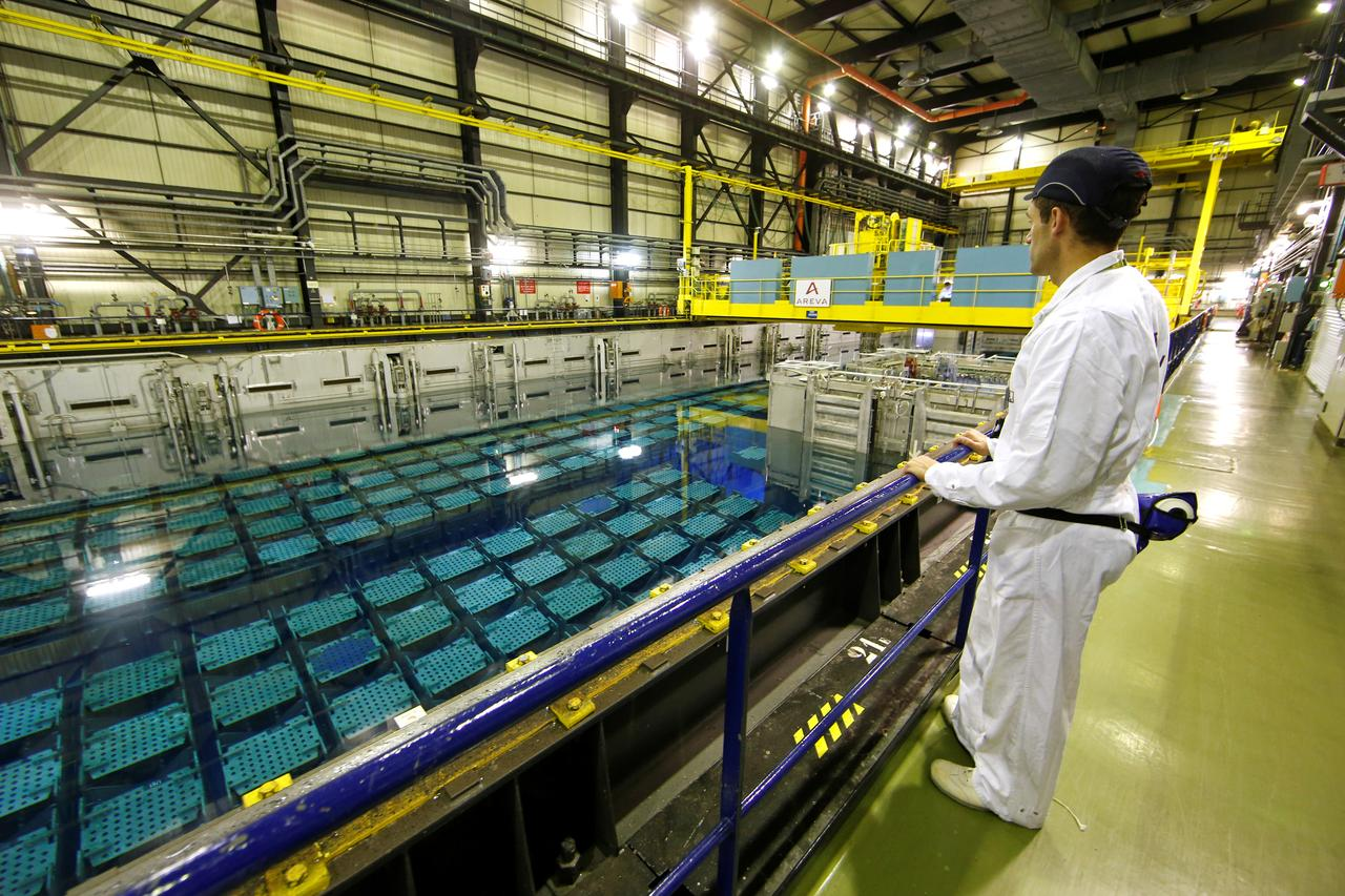 40729aaabb6d FILE PHOTO  A technician looks at the pool storage where spent nuclear fuel  tanks are unload in baskets under 4 meters of water to decrease temperature  as ...