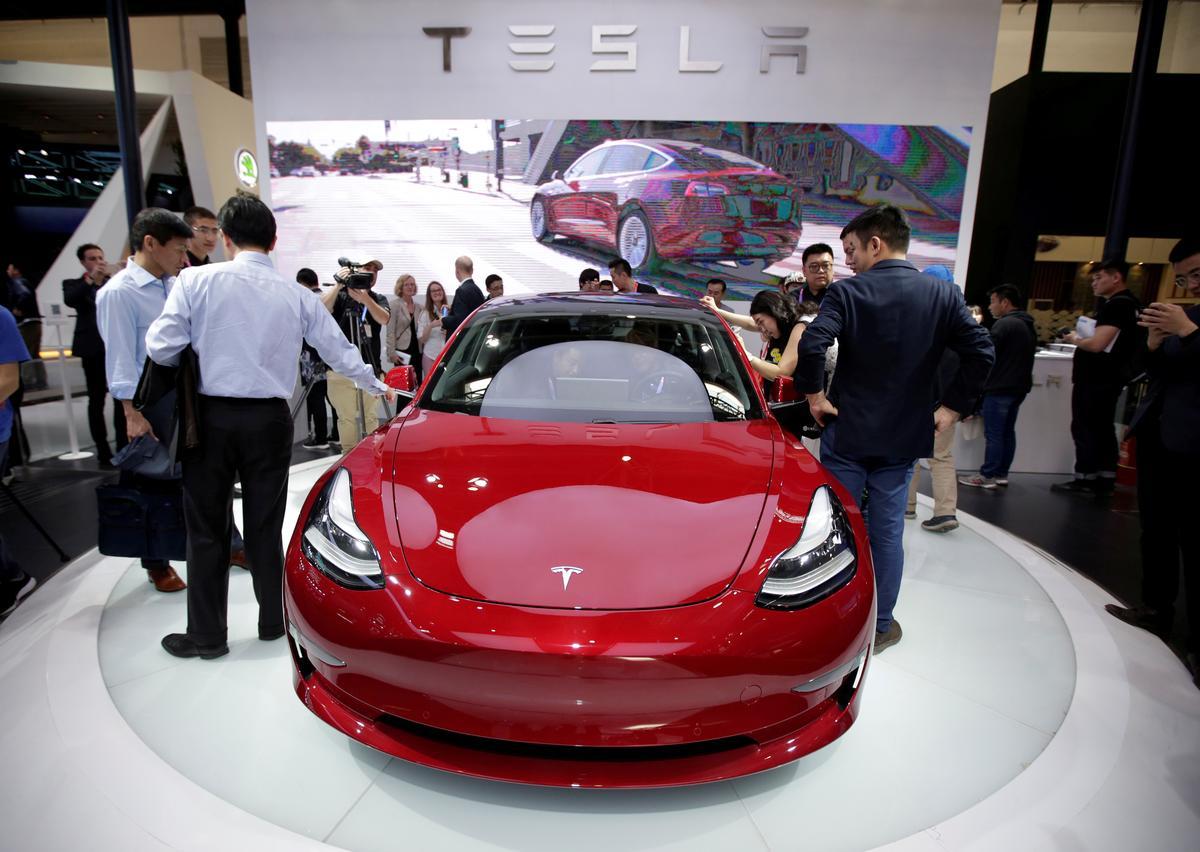 Tesla names close Musk friend Larry Ellison to board