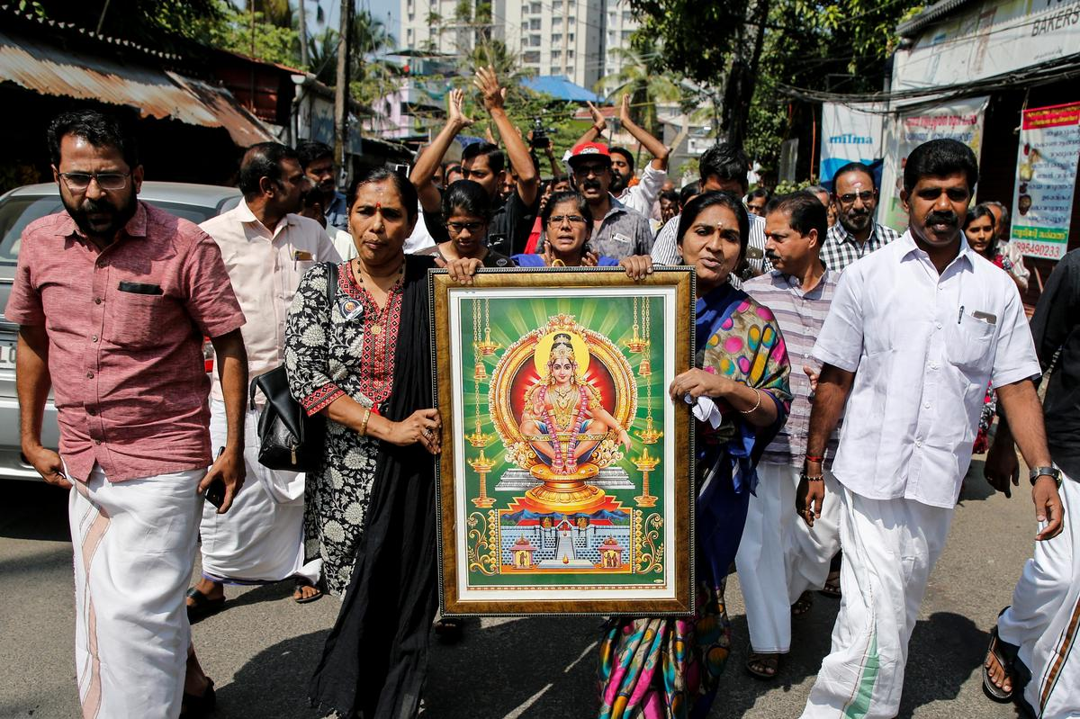 Official from India's ruling BJP calls for protests as women enter Hindu temple