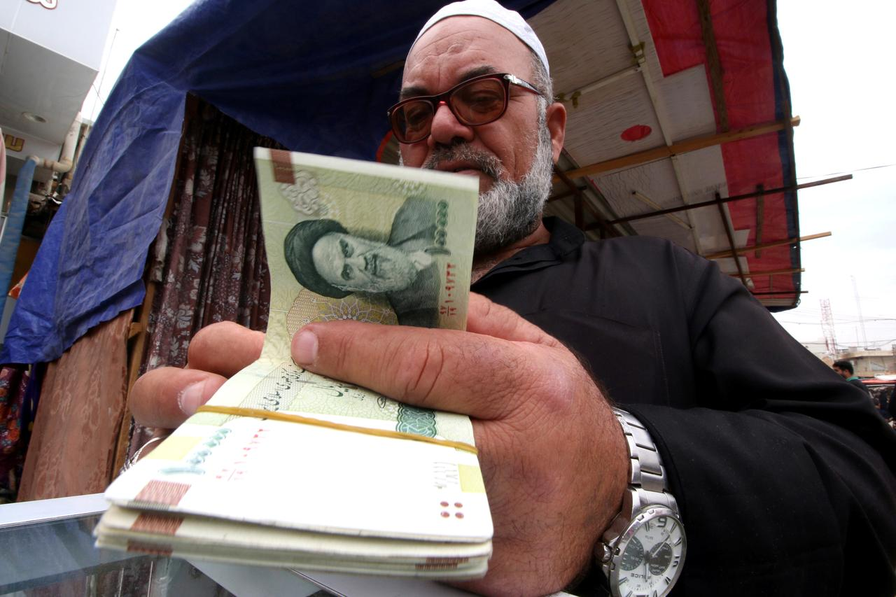 A Man S Iranian Rials From Er Of Currency Before The Start U Sanctions On Tehran In Basra Iraq November 3 2018