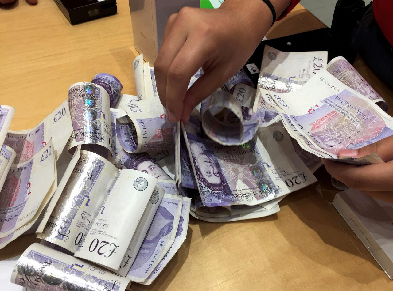 File Photo A Istant Counts Piles Of British Pound Sterling Banknotes At An Le In London Britain November 18 2017 Reuters Rus Boyce