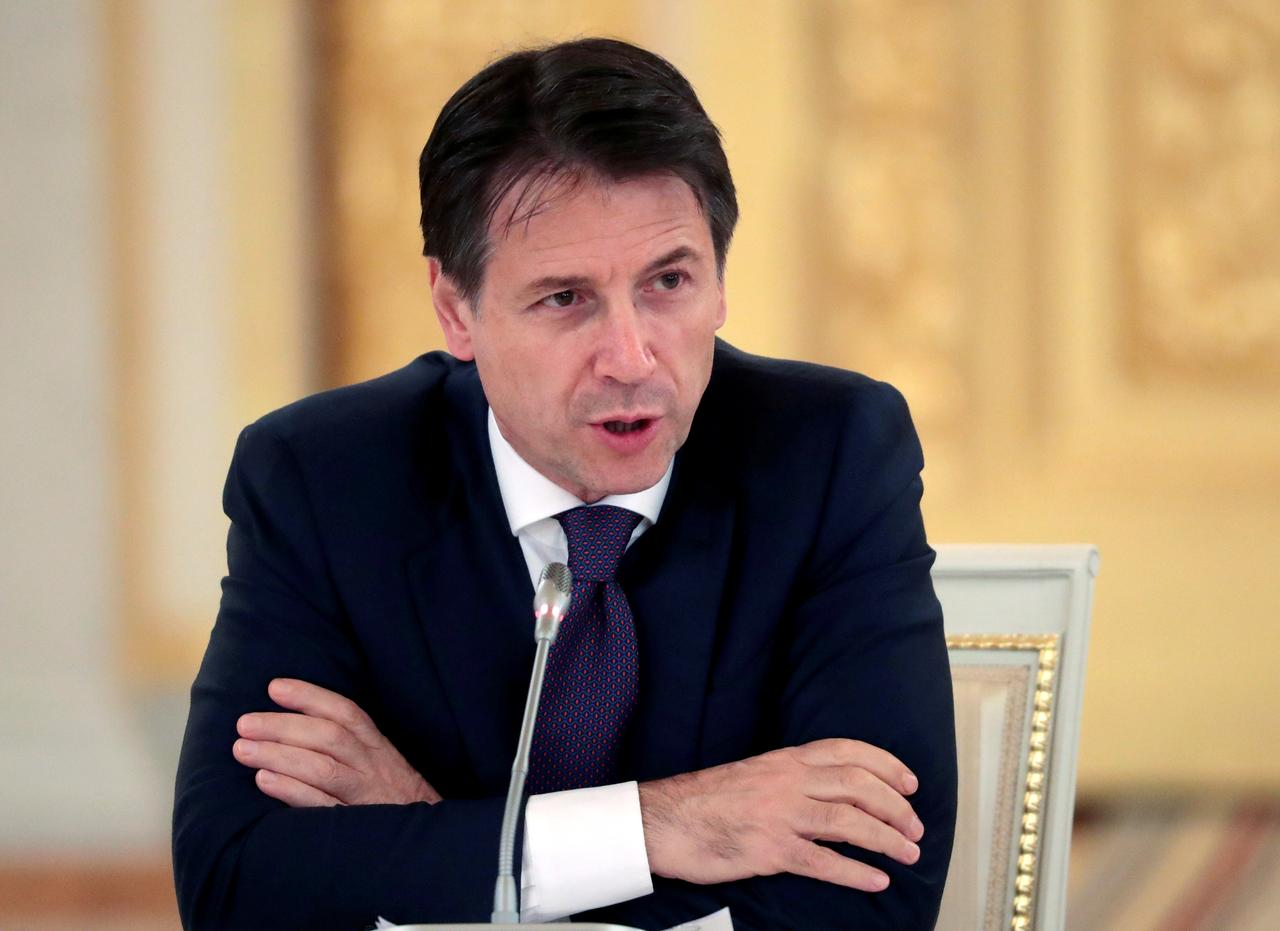 Italy government approves flagship welfare reforms - Reuters