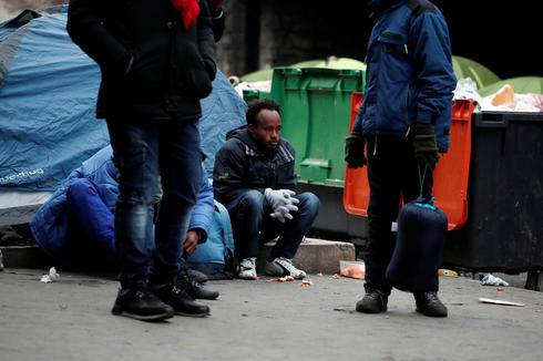 French police clear Paris migrant camp