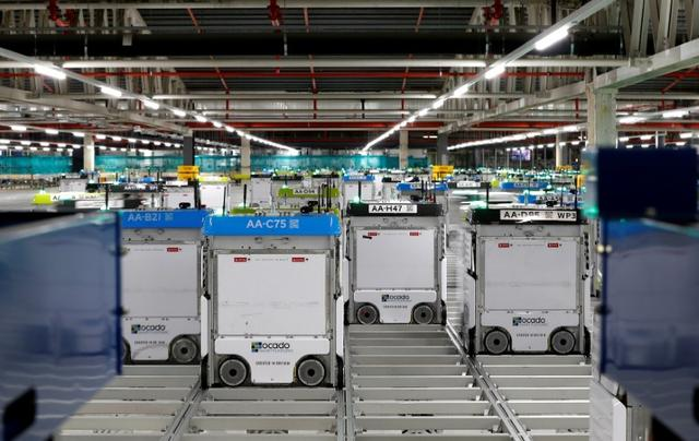 6dd5bc031a Robots are seen on the grid of the   smart platform   at the Ocado  warehouse at Andover