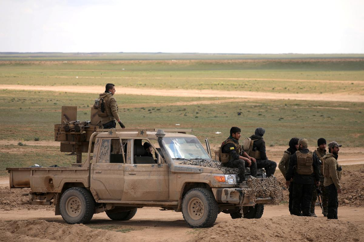 Coalition warplanes hit last Islamic State enclave in eastern Syria
