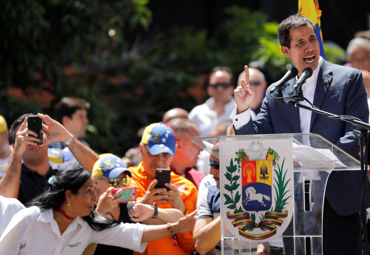 Image result for Showdown looms as Venezuela's Guaido sets aid entry date