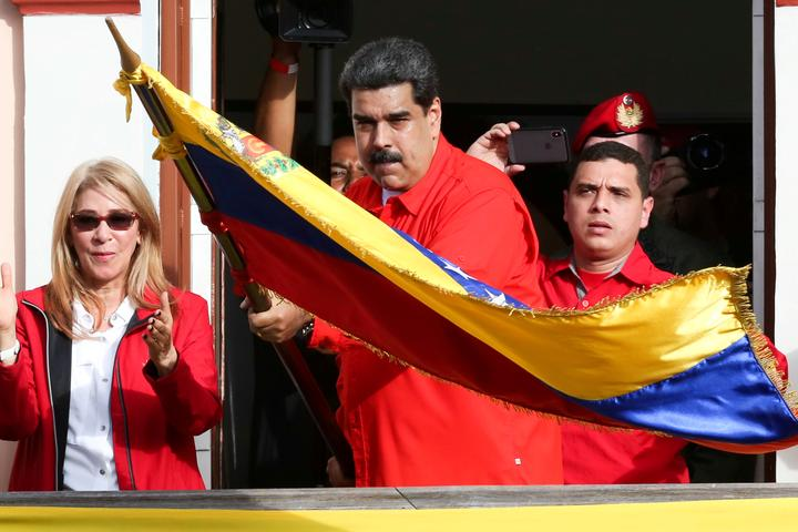 FILE PHOTO: Venezuela's President Nicolas Maduro attends a rally in support...