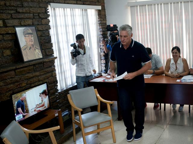 Cuba's President Miguel Diaz-Canel prepares to vote during the referendum to approve the constitutional reform in Havana, Cuba, February 24, 2019.   Ramon Espinosa/Pool via REUTERS
