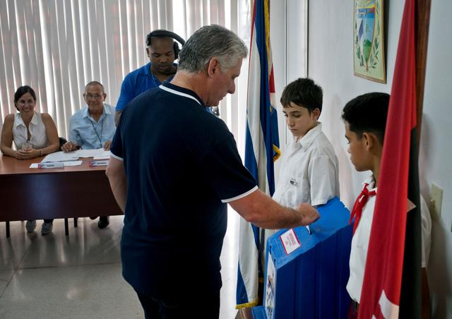 Cuba's President Miguel Diaz-Canel casts his vote during the referendum to approve the constitutional reform in Havana, Cuba, February 24, 2019.   Ramon Espinosa/Pool via REUTERS