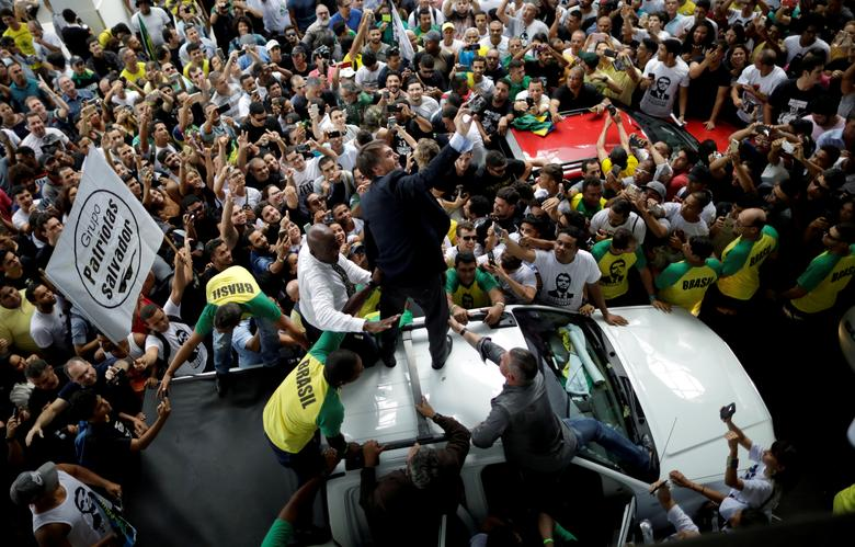 Federal deputy Jair Bolsonaro, a pre-candidate for Brazil's presidential election, is greeted by supporters as he arrives at Luis Eduardo Magalhaes International Airport in Salvador, Brazil May 24, 2018. REUTERS/Ueslei Marcelino