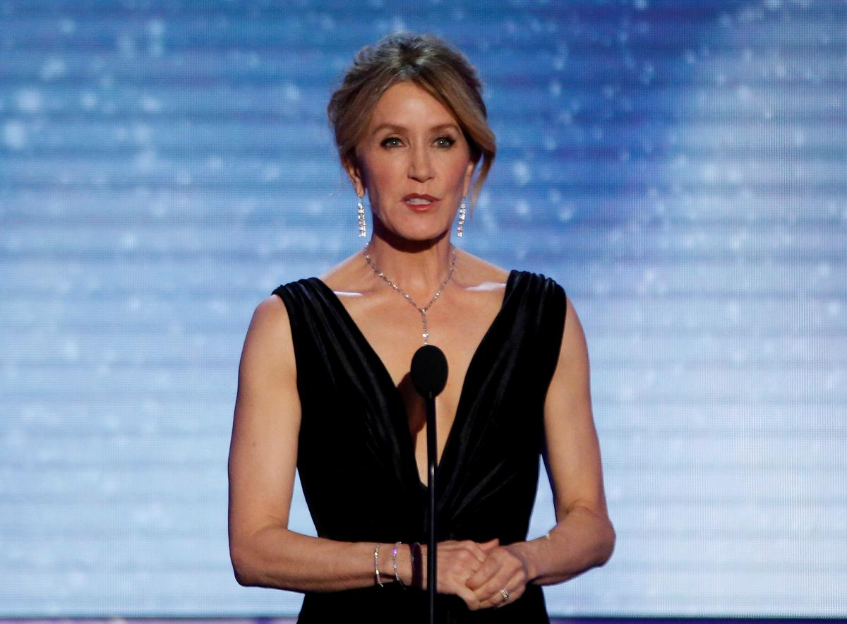Actresses Huffman, Loughlin among 50 charged in U.S. college fraud scheme