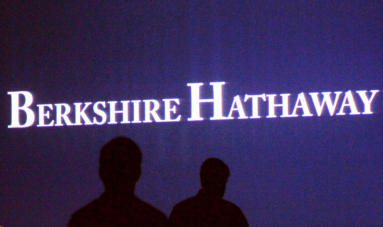 e1b7b4391f7bf Berkshire Hathaway shareholders walk by a video screen at the company s  annual meeting in Omaha May 4