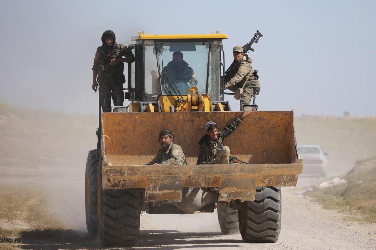 U.S.-backed fighters say operation at last Islamic State enclave not over