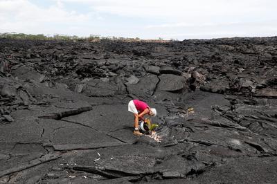 Hawaii residents return to volcano-hit homes