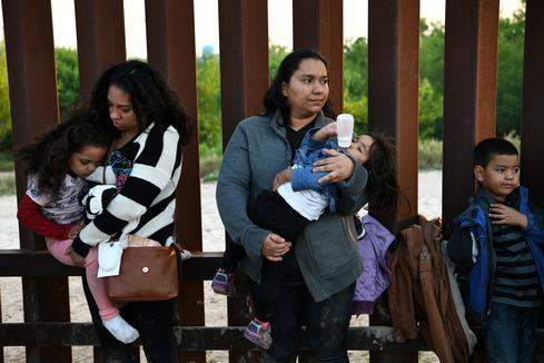 Migrants surrender at the U.S.-Mexico border