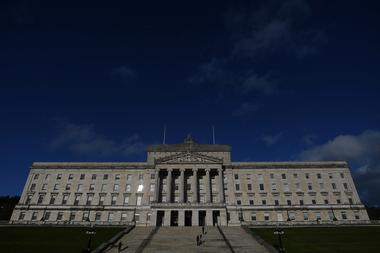 FILE PHOTO: Reporters are seen in front of Parliament Buildings at Stormont...