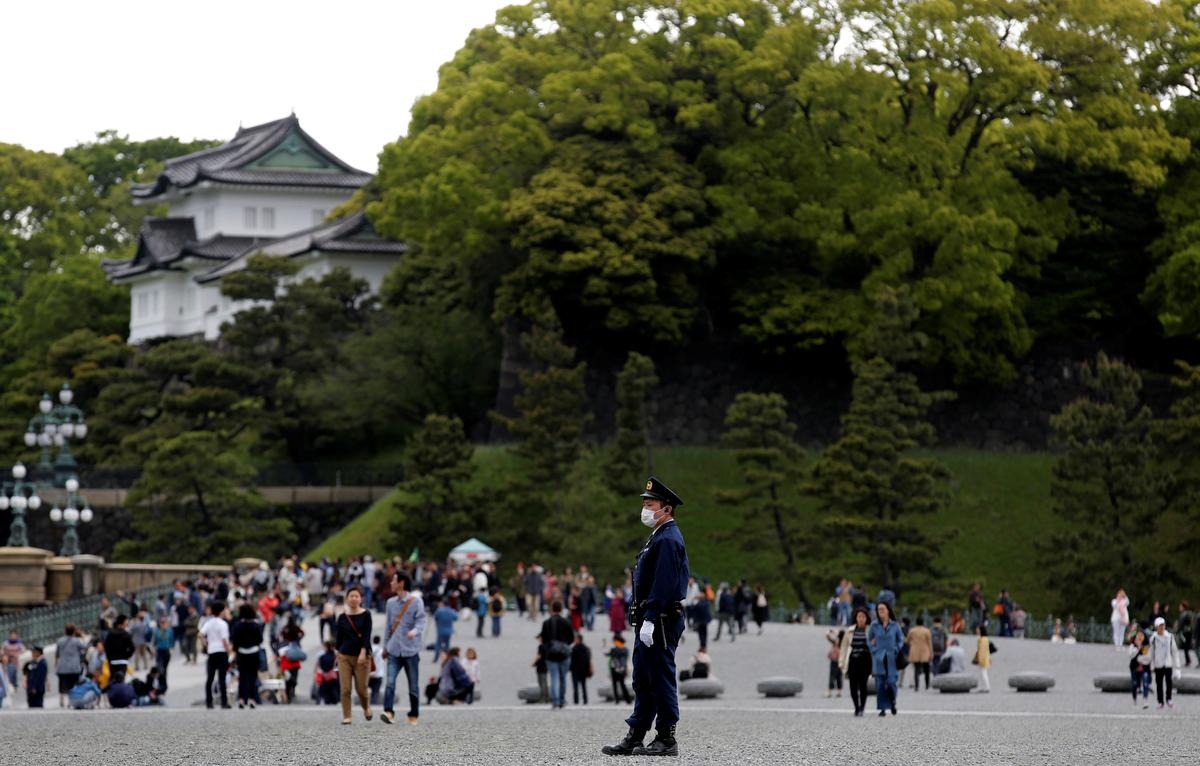 Security beefed up in Tokyo as emperor prepares to abdicate