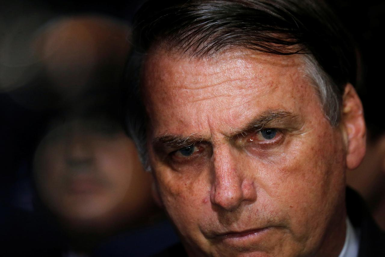 Brazil's Bolsonaro signs decree easing gun import, ammo limits - Reuters