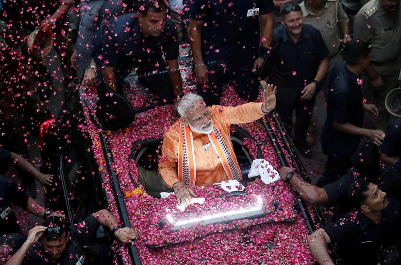 reuters.com - Reuters Editorial - India's Modi-led coalition likely to win majority, exit polls show